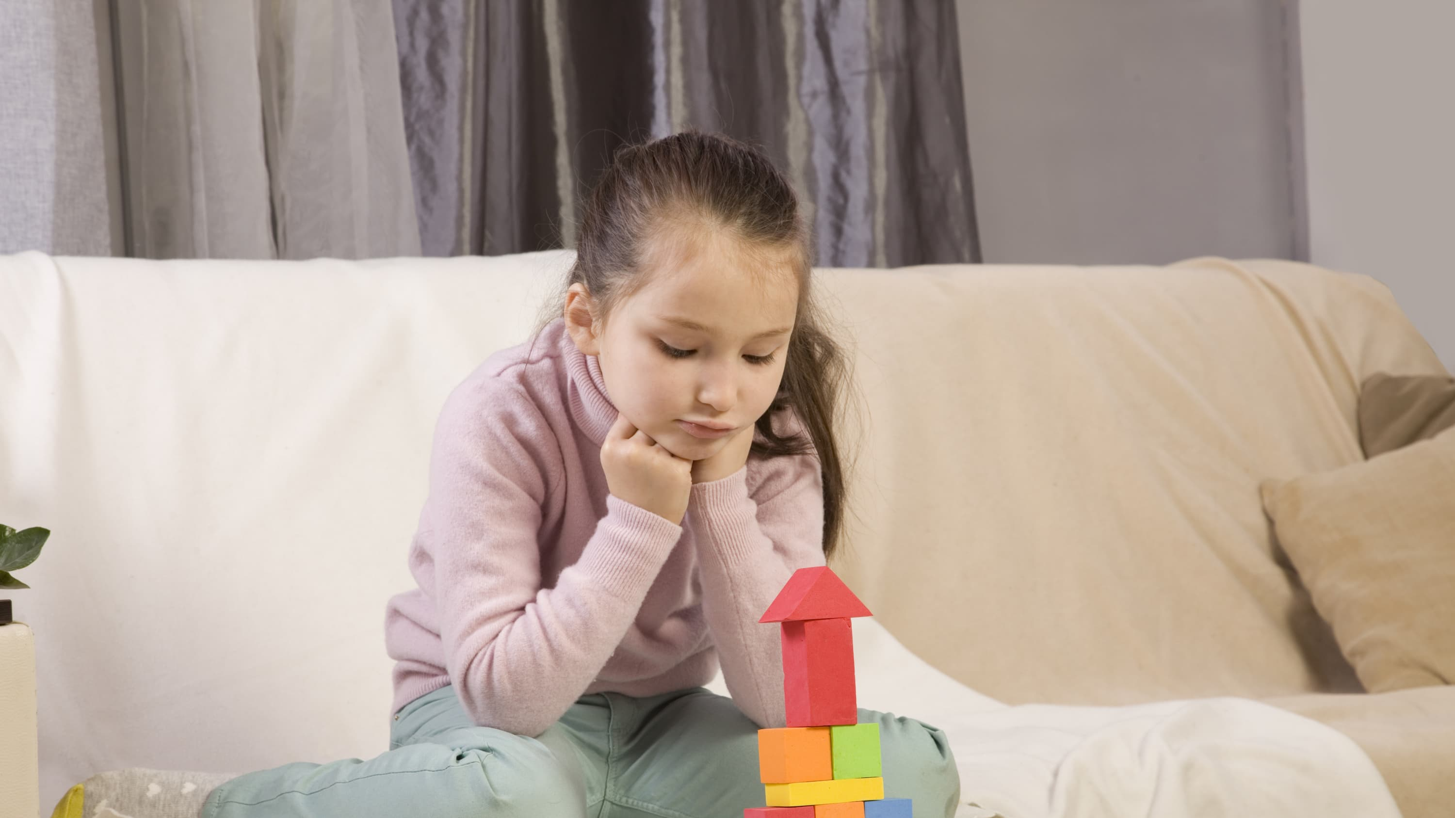 A child playing with blocks may have obsessive-compulsive disorder.