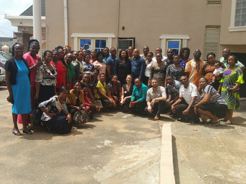Participants and instructors of the HAPPINESS Project gather for a group photo after a training session.