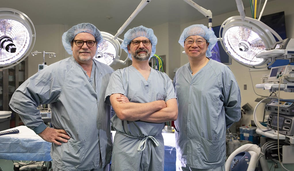 In the specialized Yale New Haven Children's Hospital heart center operating room are (left to right) Dr. Peter J. Gruber, Dr. Jeremy Asnes, and and Dr.T-Y Hsia.