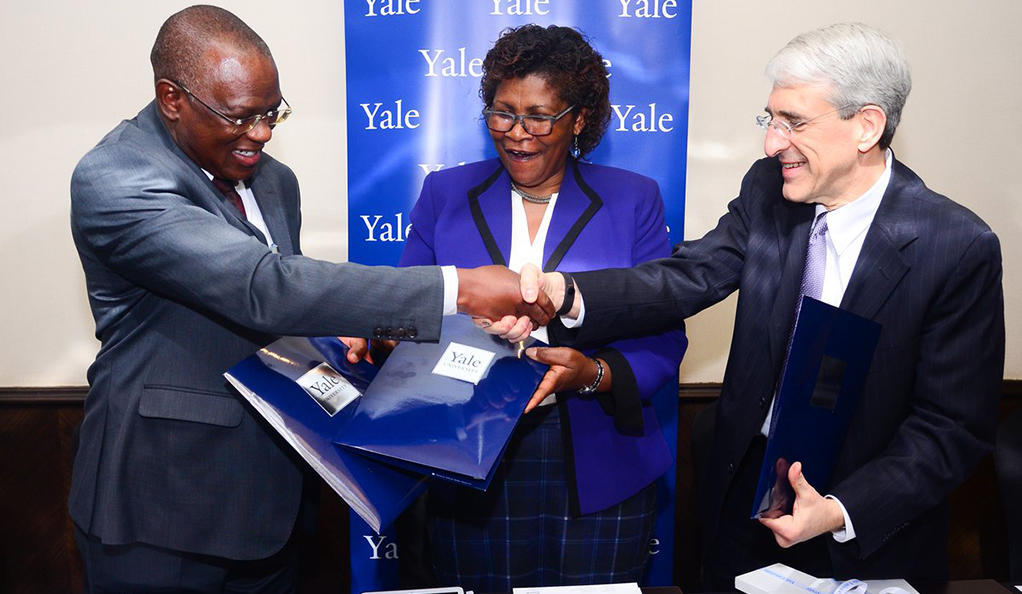 Dr. Sam Kasiki, Deputy Director General of the Kenyan Wildlife Service; Dr. Felister Makini, Deputy Director General of the Kenya Agricultural Research and Livestock Organization; and Yale President Peter Salovey during a ceremony to continue a biomedical collaboration that aims to develop a more thorough understanding of the biology of parasitic diseases.