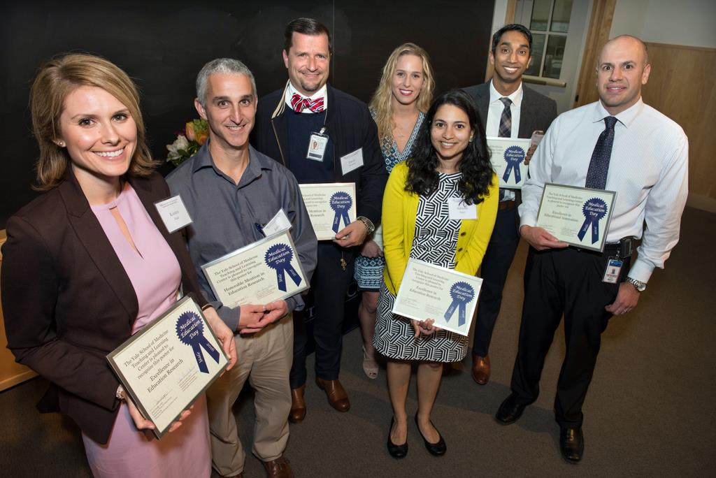 Awards for outstanding posters in Innovation in Education and Education Research went to (from left) Kristen Rake, John Giuliano Jr., David Brissette, Amanda King, Ashwini Bapat, Thilan Wijesekera, and Daniel DiCapua.