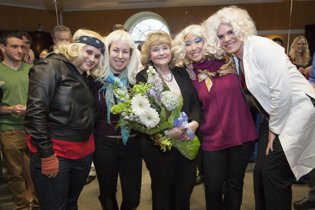 Jessi Gold, Jessica Berger, Alice Lu, and Sam Sondalle dressed up as Peggy Bia, center, at a reception in her honor.