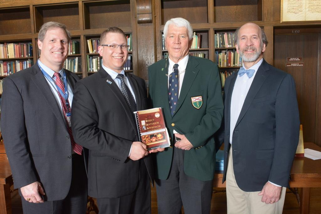 Theodore Blaine, Lee Rubin, Kristaps Keggi, and Gary Friedlaender at a ceremony marking the publication of a book by Rubin and Keggi on hip replacement surgery.