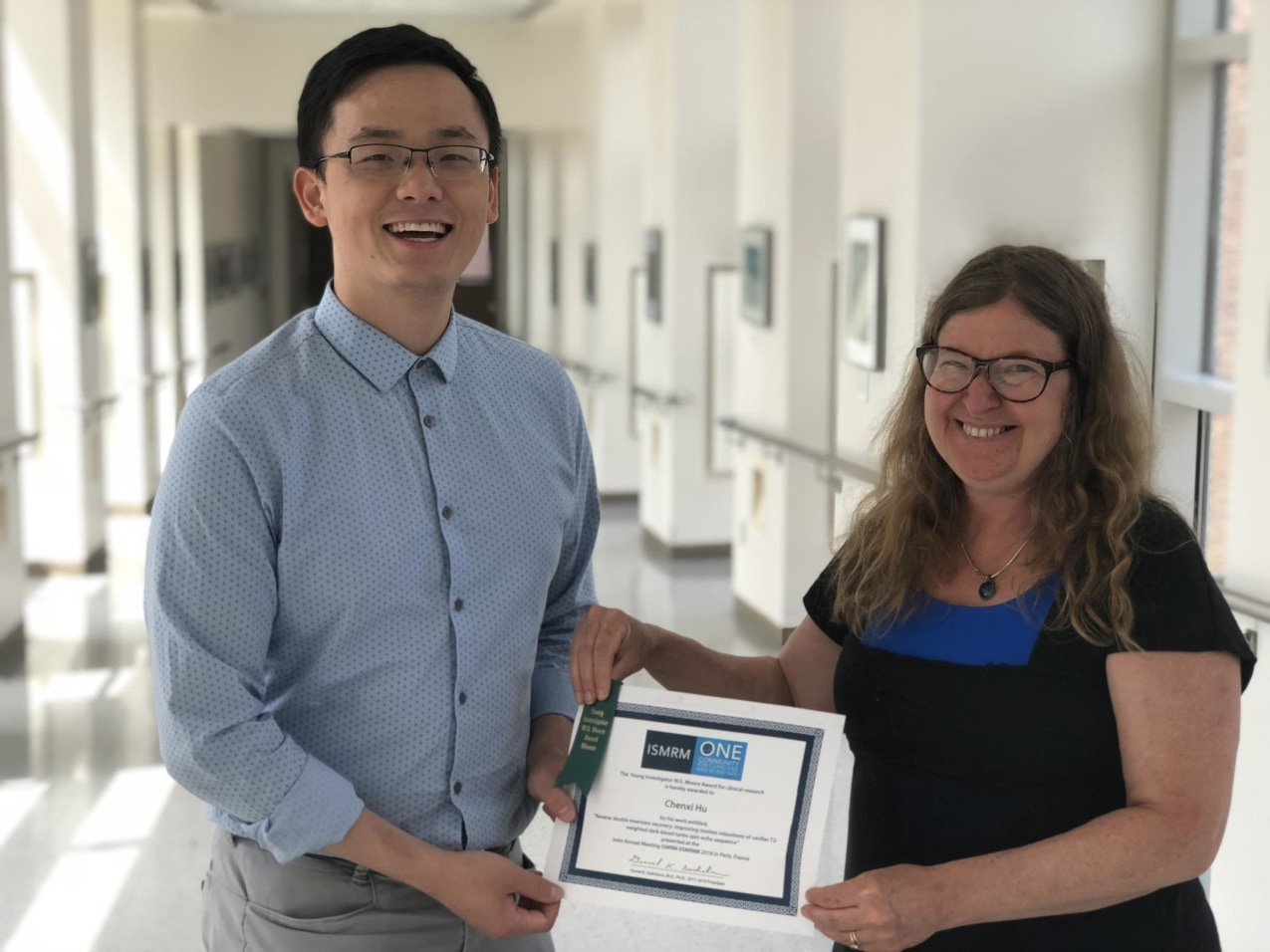 Chenxi Hu received the Young Investigator Award