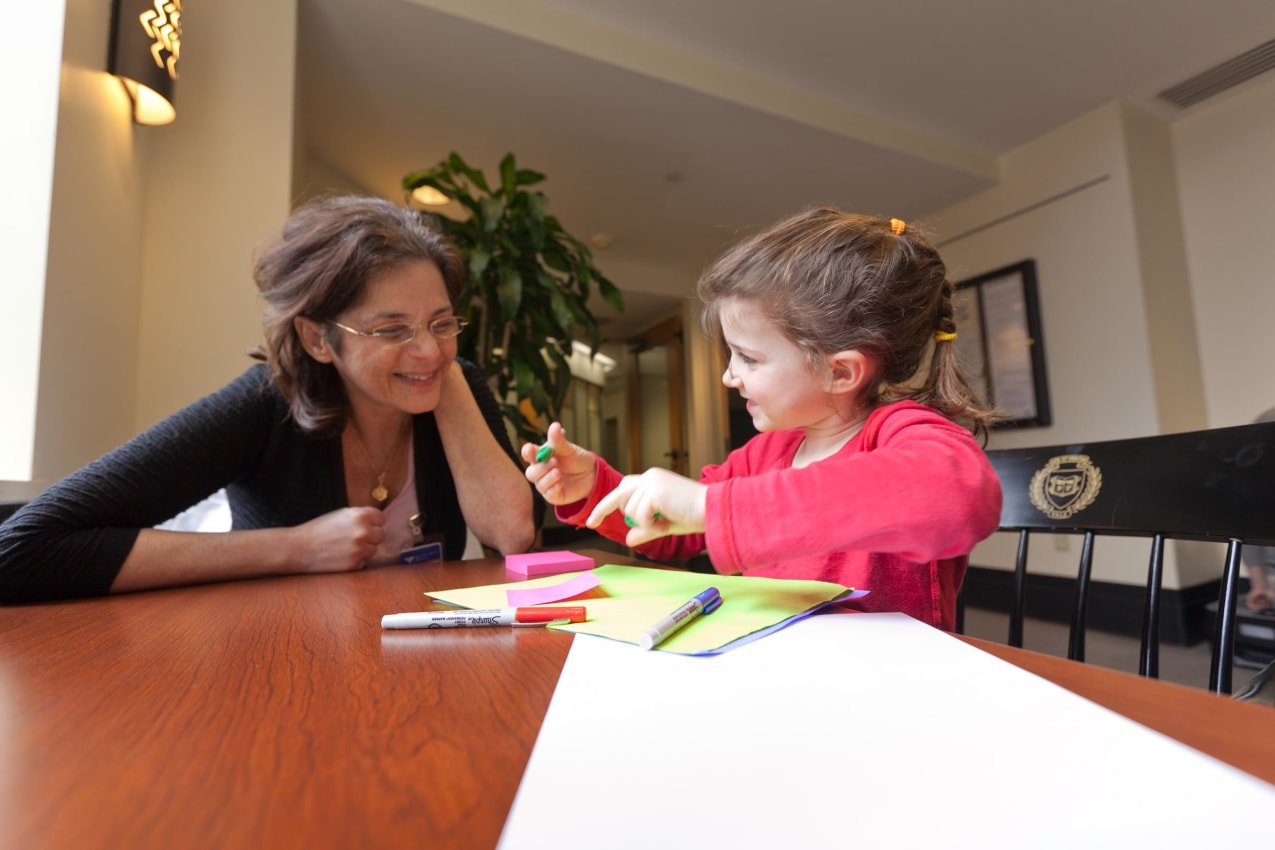 Dr. Szekely interacts with a program participant.