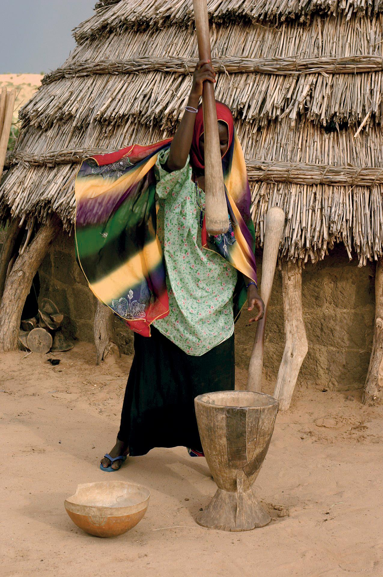 woman pounding grain