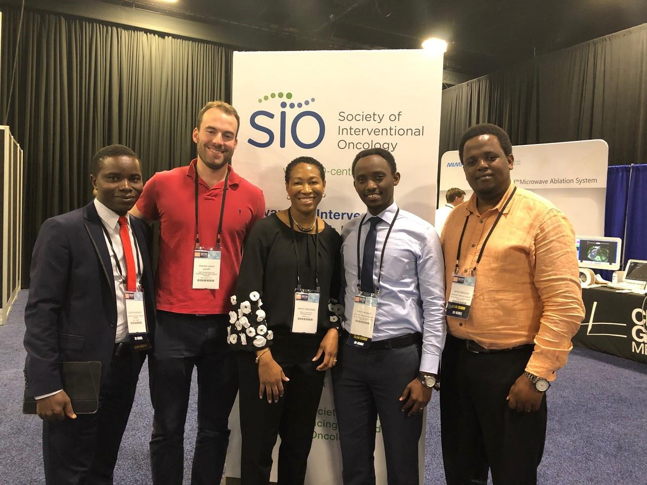 Trainees from Nigeria, Tanzania, and the US with Dr. Newsome from Emory at WCIO 2018