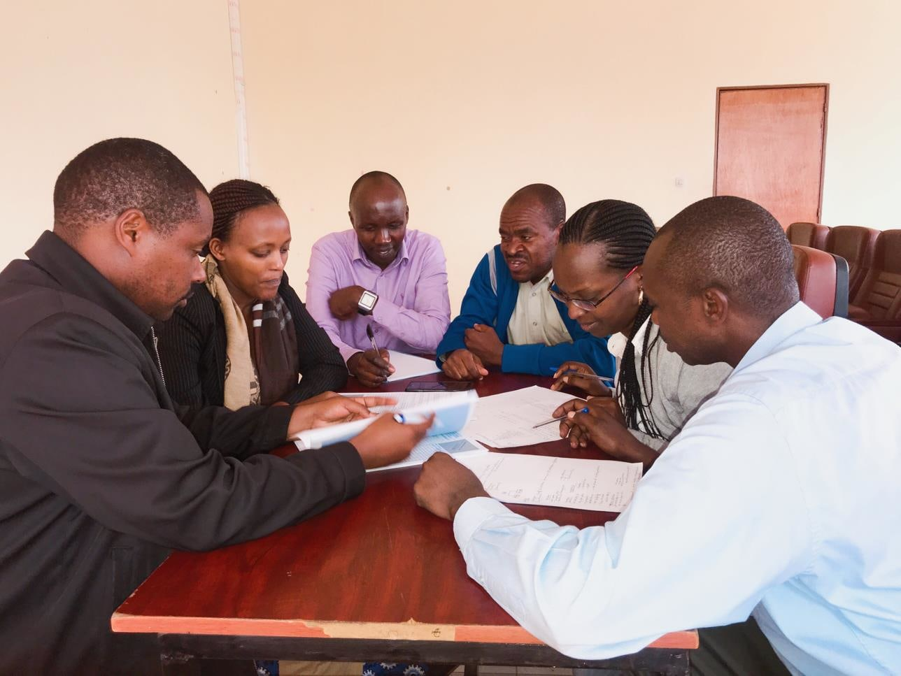 MHA students at the University of Rwanda put their heads together and apply their problem solving skills.