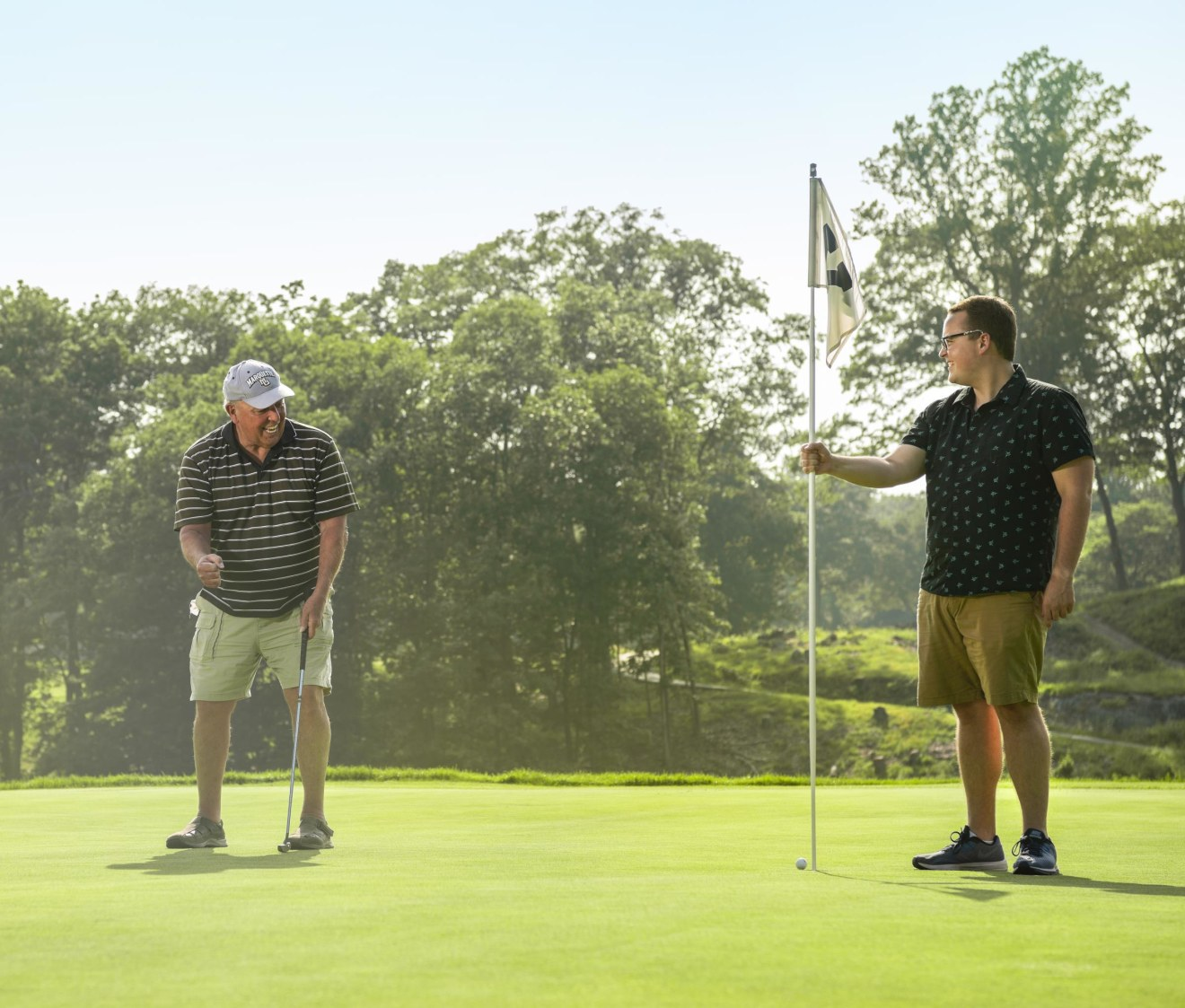Joe golfing with son