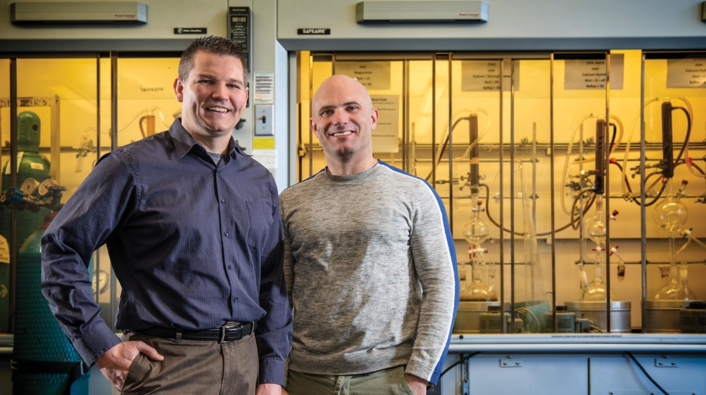 Jason Crawford, PhD left and Seth Herzon standing in their lab