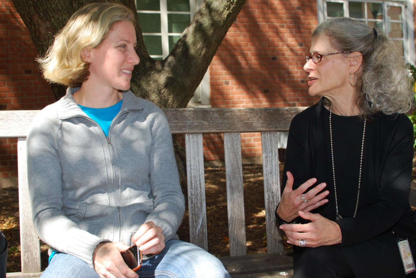 Associate Dean of Student Affairs talking with a student
