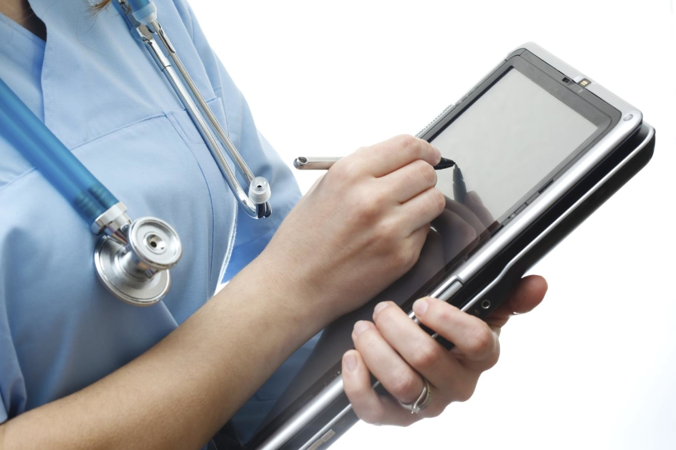 Nurse writing notes on a tablet