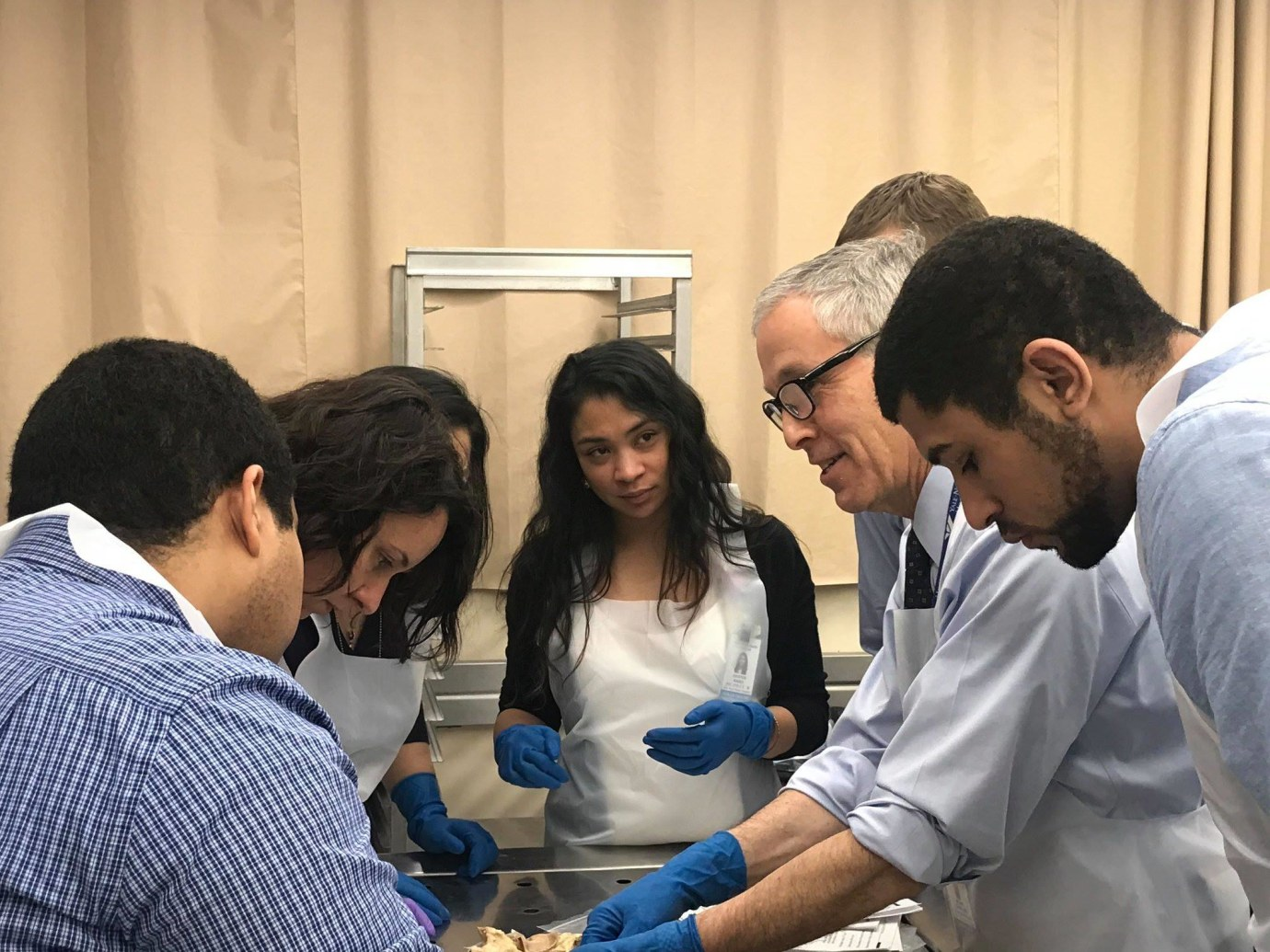 Fellows reviewing heart pathology specimens with Dr. Henry Cabin.