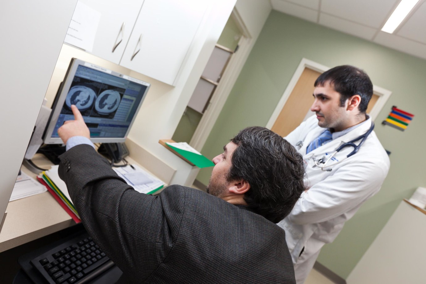 Doctors referencing a scan on the computer