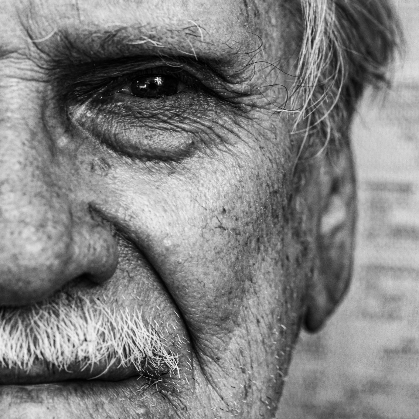 Close up detail of man's face in black and white.