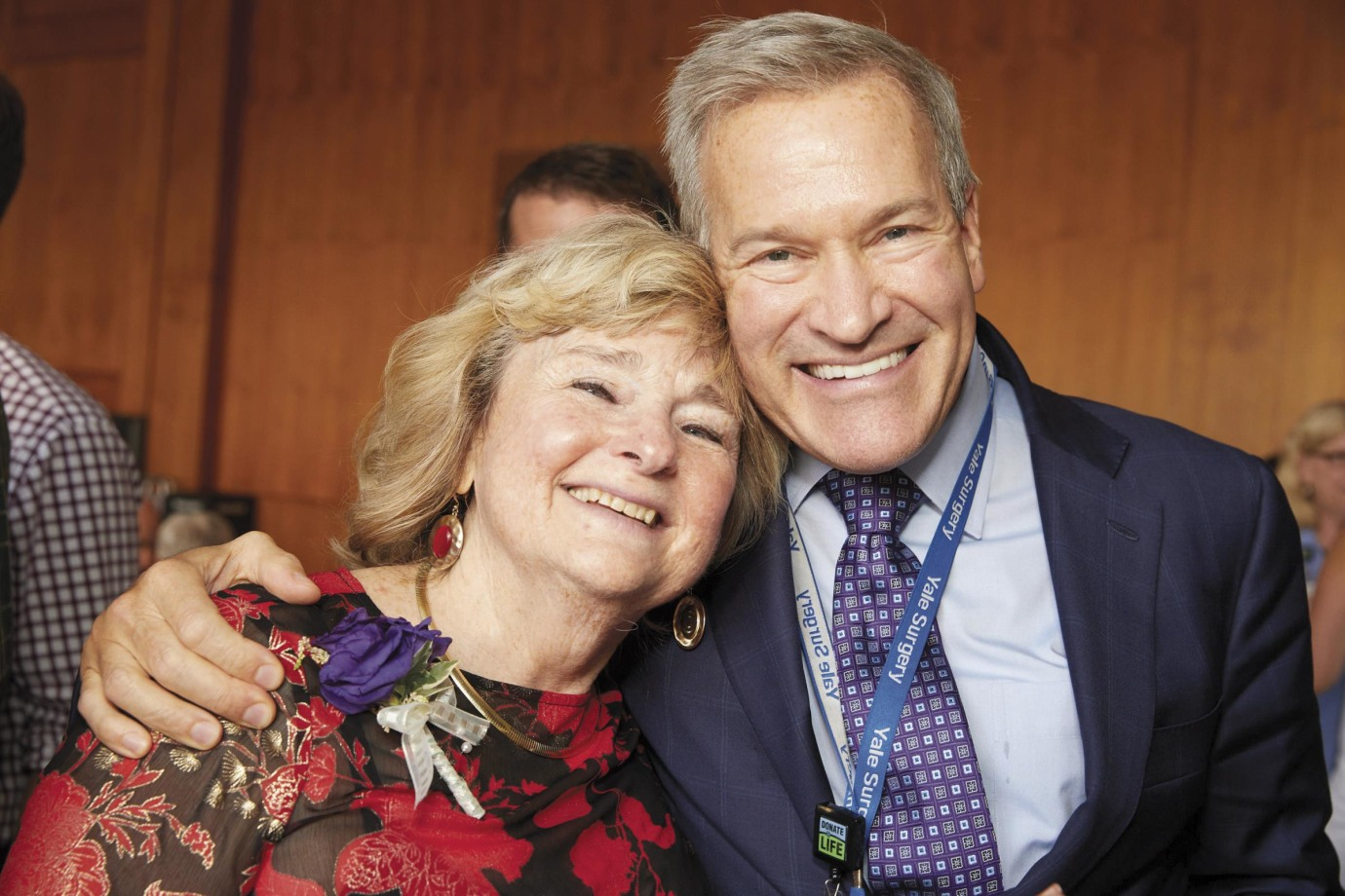 """Margaret """"Peggy"""" Bia, MD, FW '78, surrounded by former patients, colleagues, friends, and well-wishers, like David Mulligan, MD."""