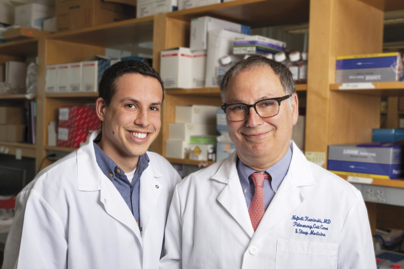 Naftali Kaminski (right) is accelerating his lab's research into idiopathic pulmonary fibrosis (IPF), a disease that devastates the lungs, thanks to a gift from Three Lakes Partners, a venture philanthropy group whose mission is to conquer IPF. In 2017, lab member Taylor Adams (left) presented encouraging data that focused attention on the progress Kaminski and his team are making.