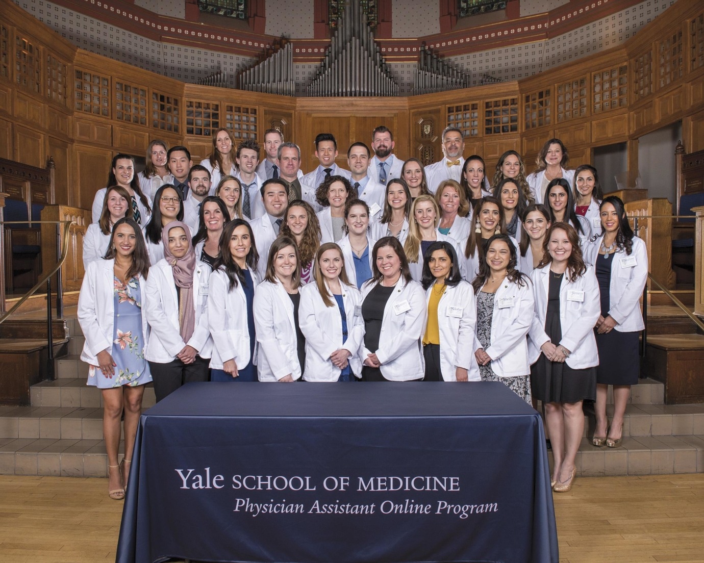 The first class enrolled in the School of Medicine's inaugural physician assistant online program came to Yale in March and received their ceremonial white coats at Battell Chapel.
