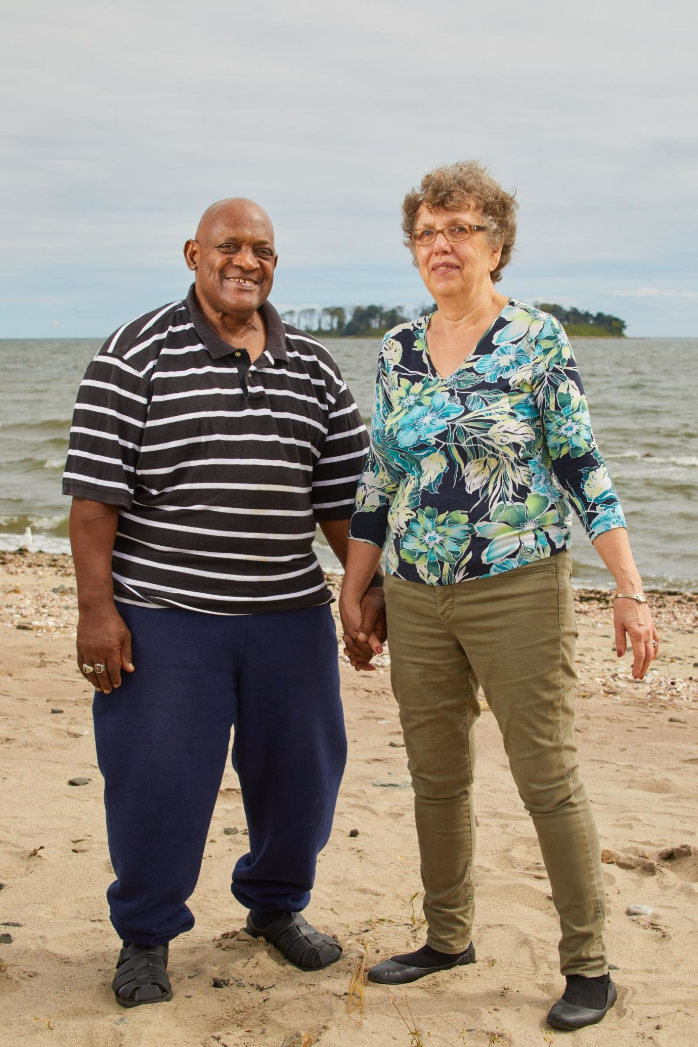 Help us Discover Heroes Frank and Lynn enjoy practicing mindfulness with some yoga on the beach