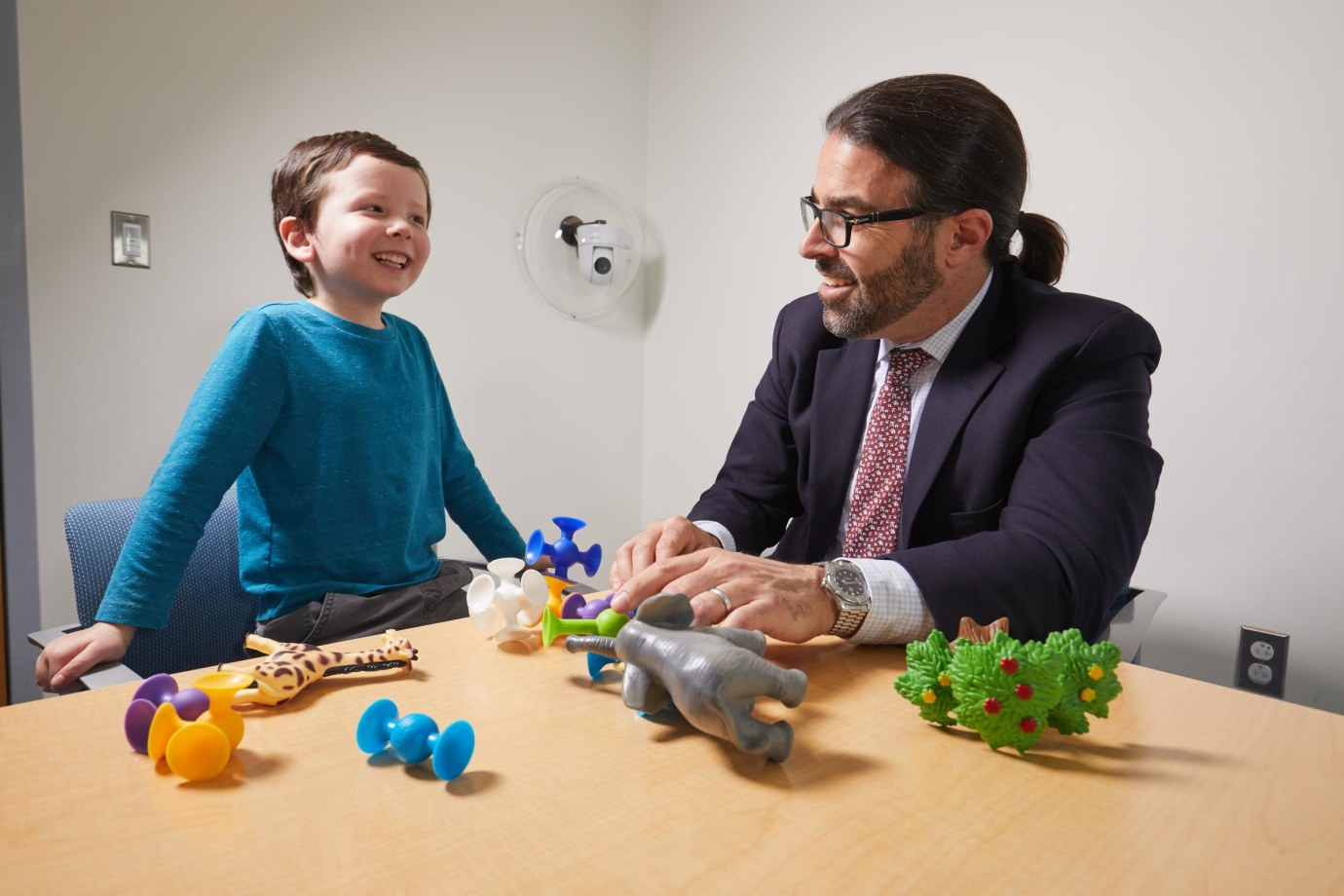 Dr. James McPartland with child in a study