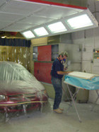 Priming in a prep station protects other workers and the paint job.