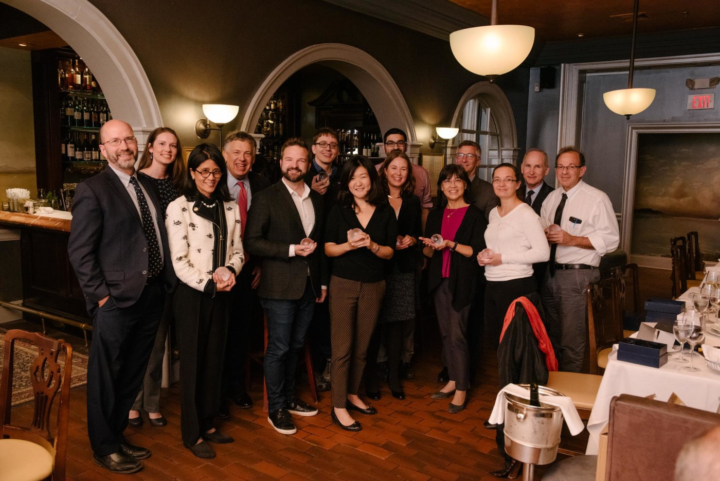 group photo of speakers at dinner