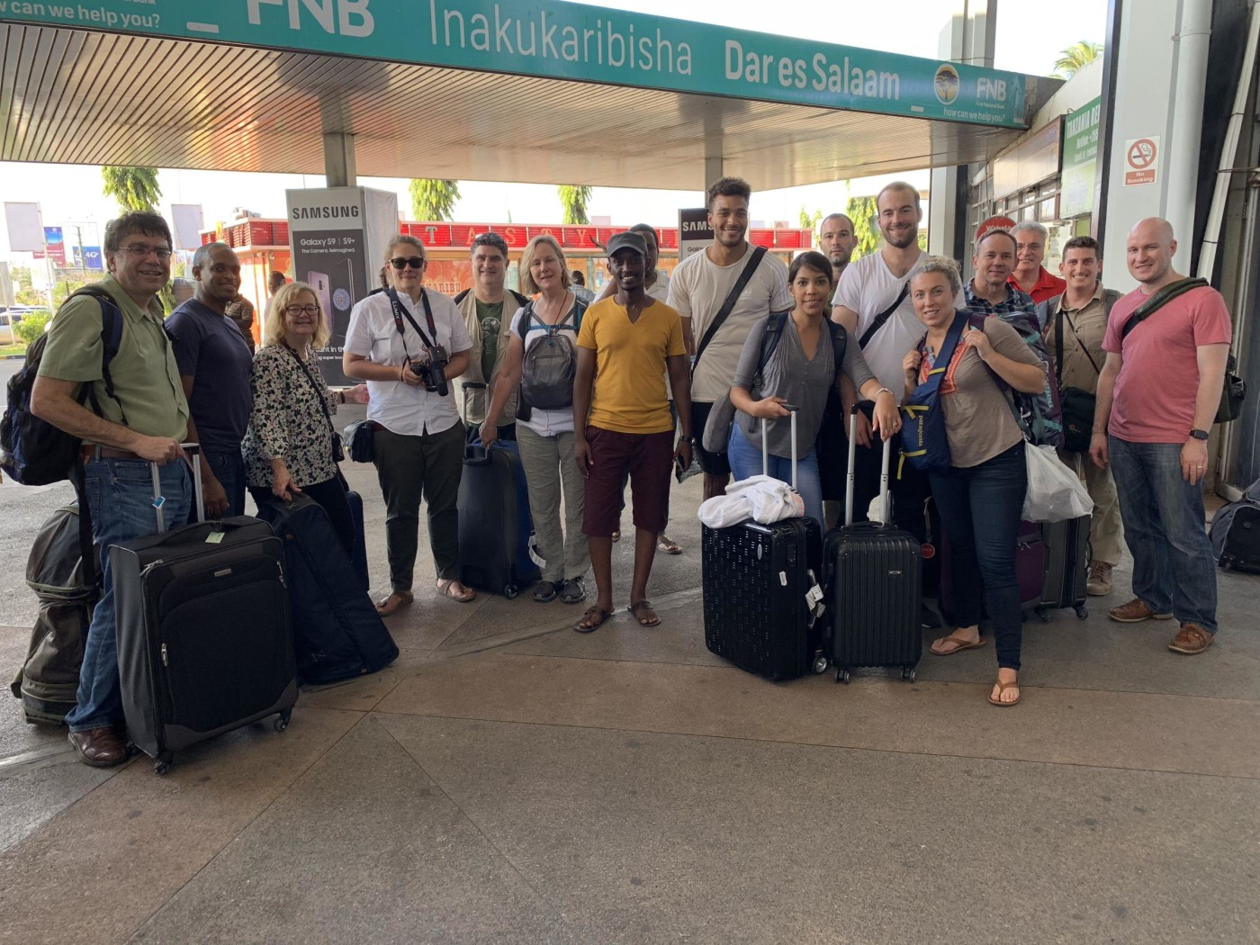 The first team shown on arrival at Julius Nyerere International Airport in Dar es Salaam, Tanzania on Sunday, October 21, 2018: five radiology attending physicians, (Yale, Dartmouth and West Haven VA Hospital), an IR nurse and IR technologist (Yale-New Haven Hospital), four radiology residents (Yale and Dartmouth), a medical student (Bonn, Germany), a pathologist, a spouse extraordinaire, and host Ivan Rukundo, MD, MUHAS radiology resident.