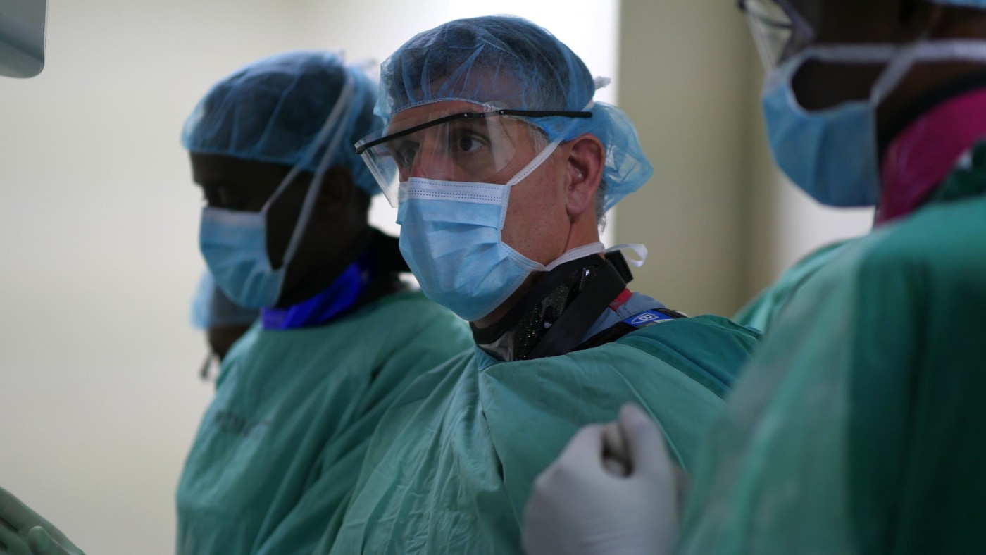 Dr. David Prologo from Emory during a procedure with Tanzanian IR residents.