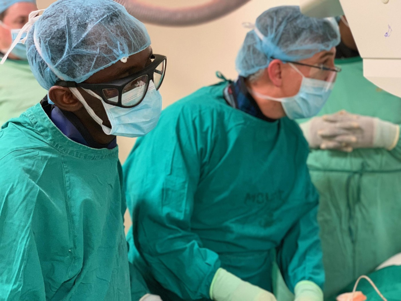 Drs. Ivan Rukundo and David Prologo during a biliary drainage procedure.