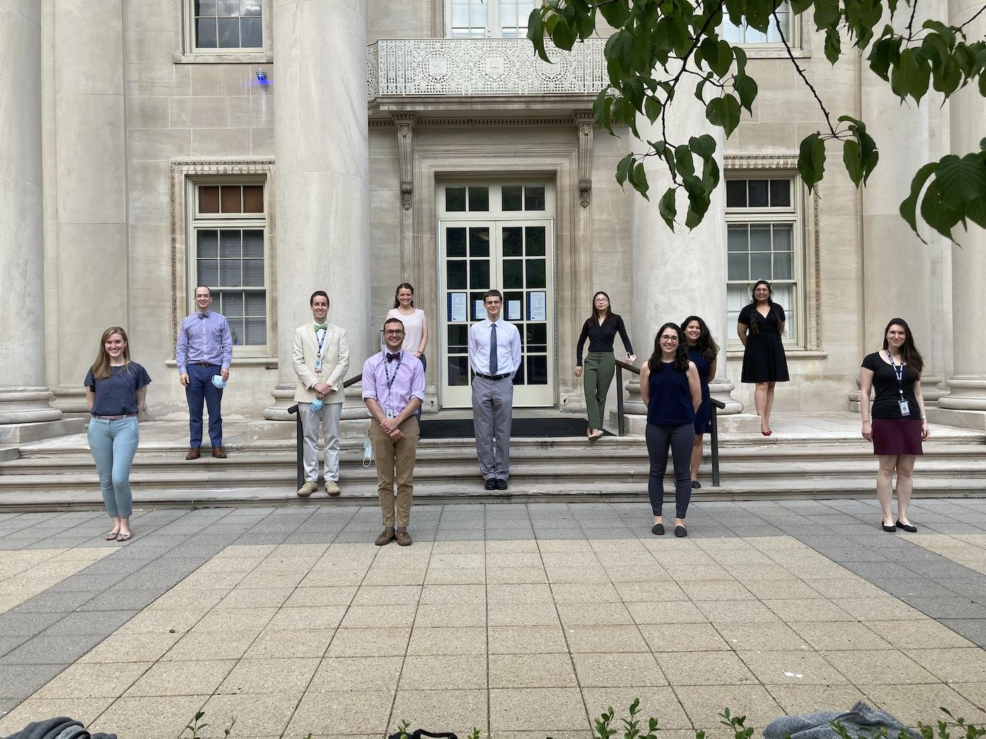 Class of 2023 standing in front of Sterling Hall of Medicine