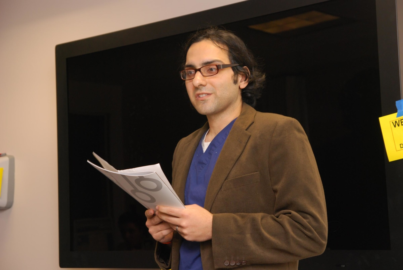 Resident Boback Ziaeian introduced other residents in the Writers' Workshop as they read from their published works.