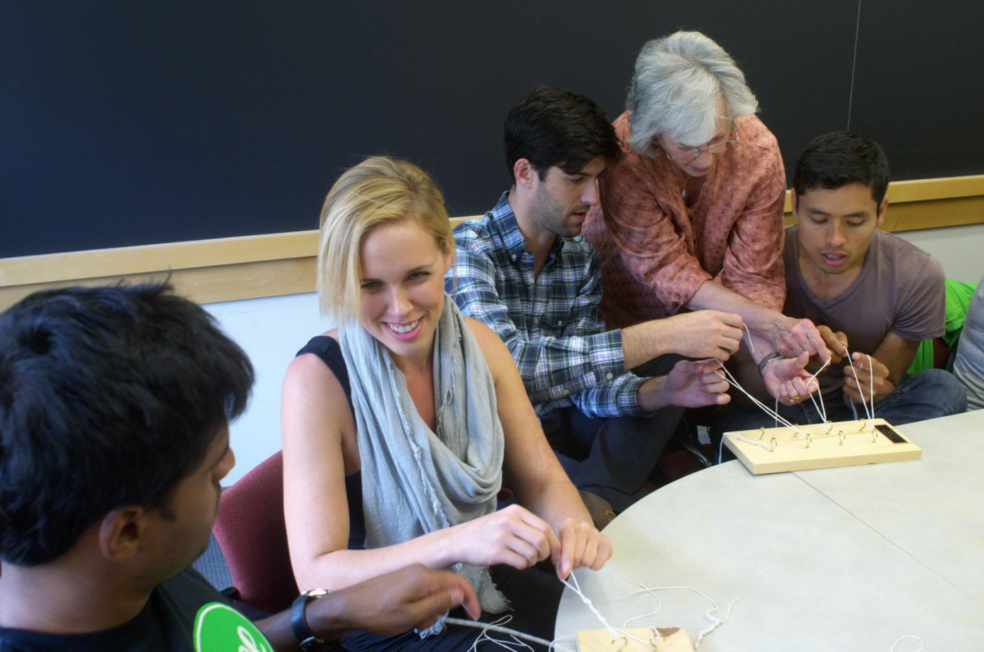 Ravi Gupta, Erica Giles, Evan Levy, and Alex Domingo learn the ropes from Susan Richman.