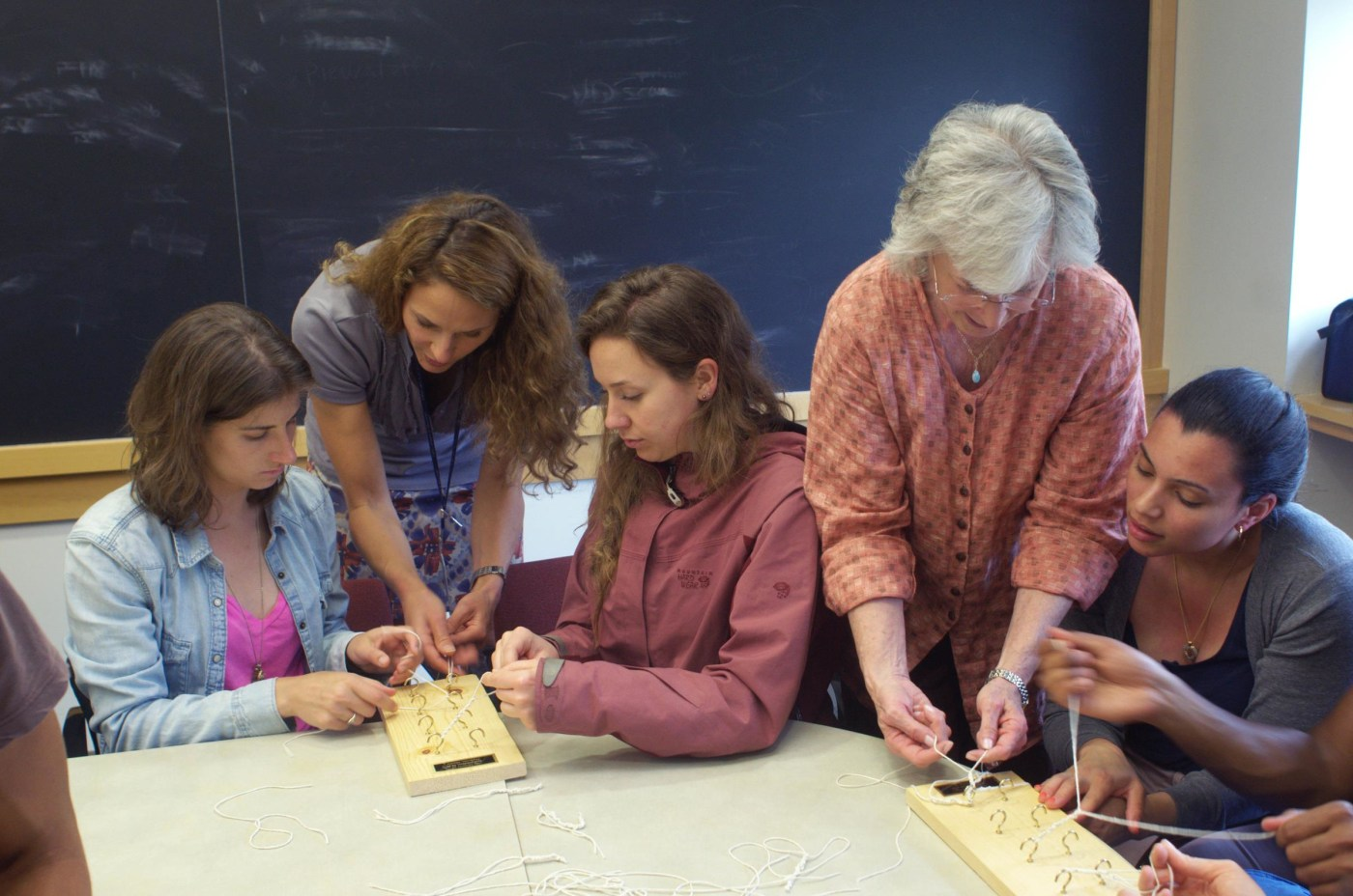 Sam Kaplan, Jessica Johnston, and Jessica Buckley get help in knot-tying from Rebecca Pringle and Sue Richman.