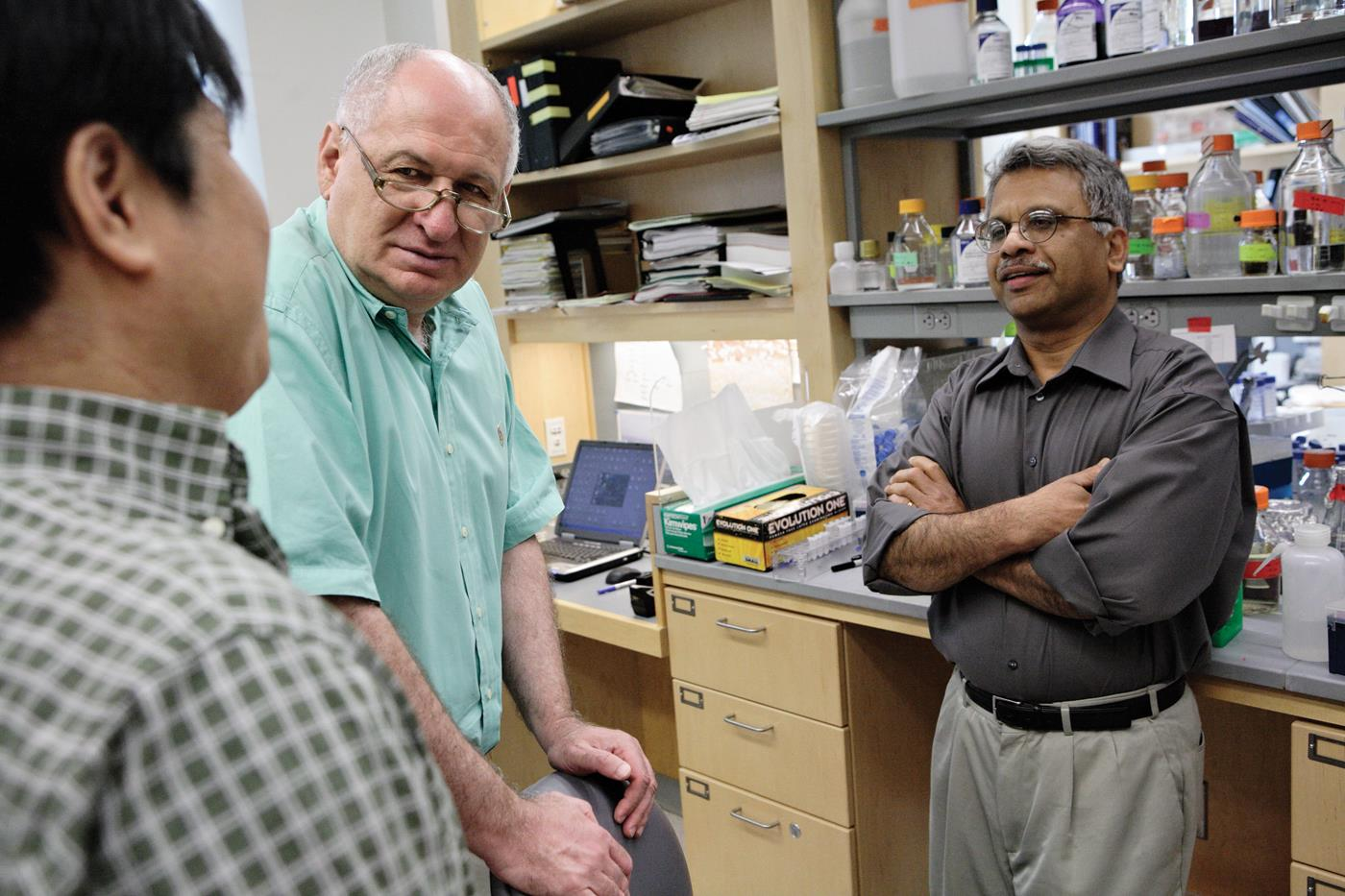 Schlessinger confers with members of his lab team