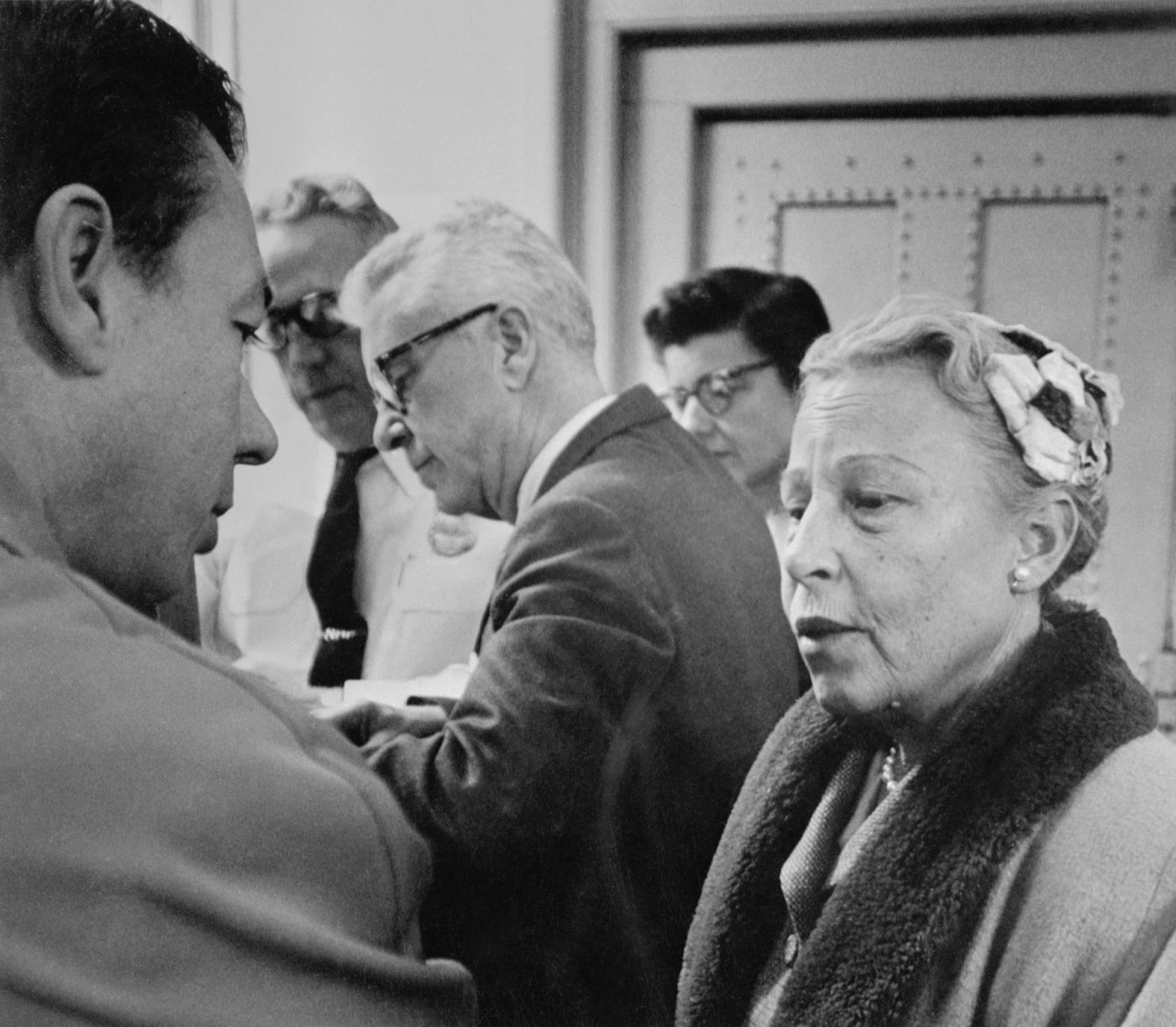 Estelle Griswold and C. Lee Buxton, center, in police headquarters on November 10, 1961.