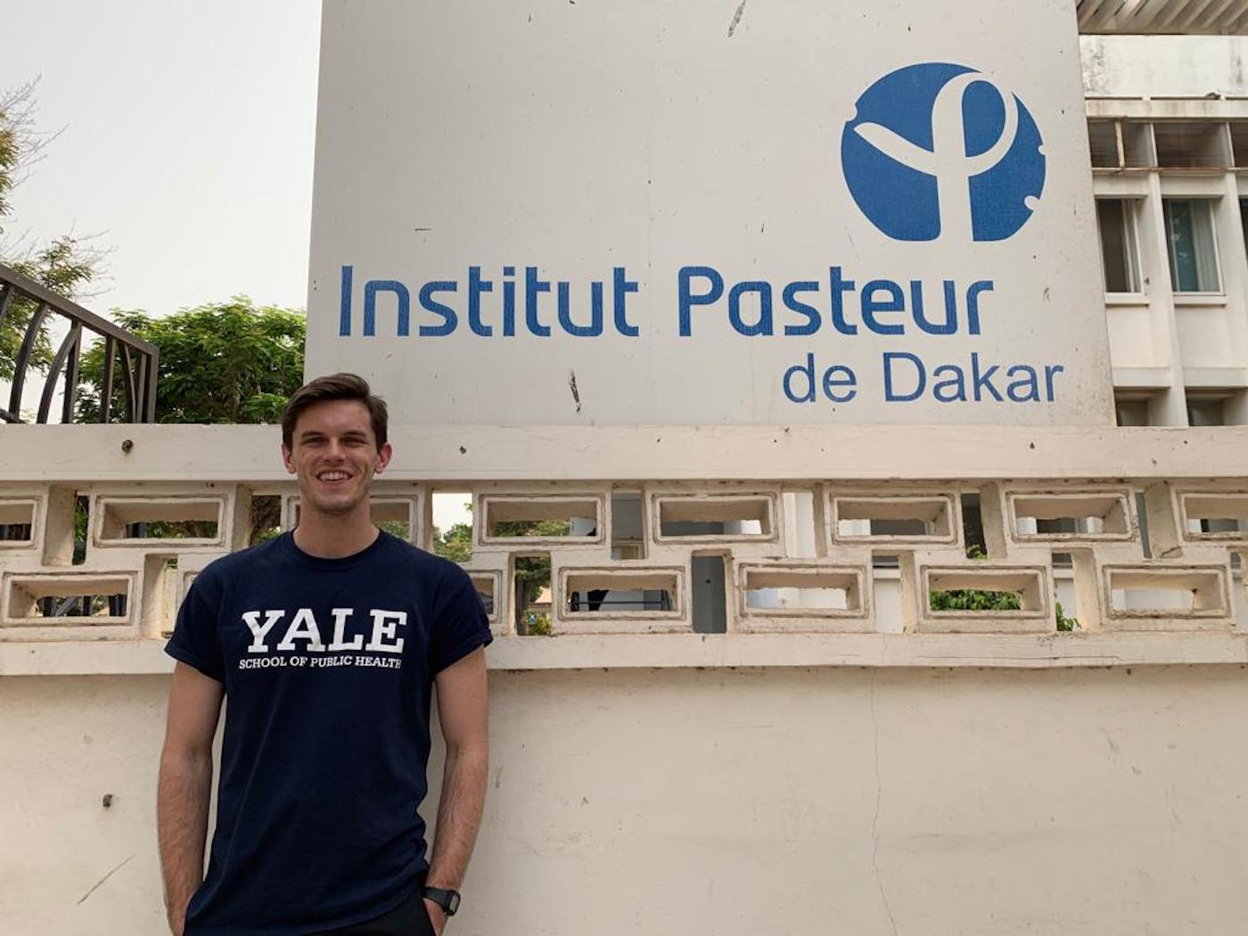 Adam in front of the Instut Pasteur De Dakar