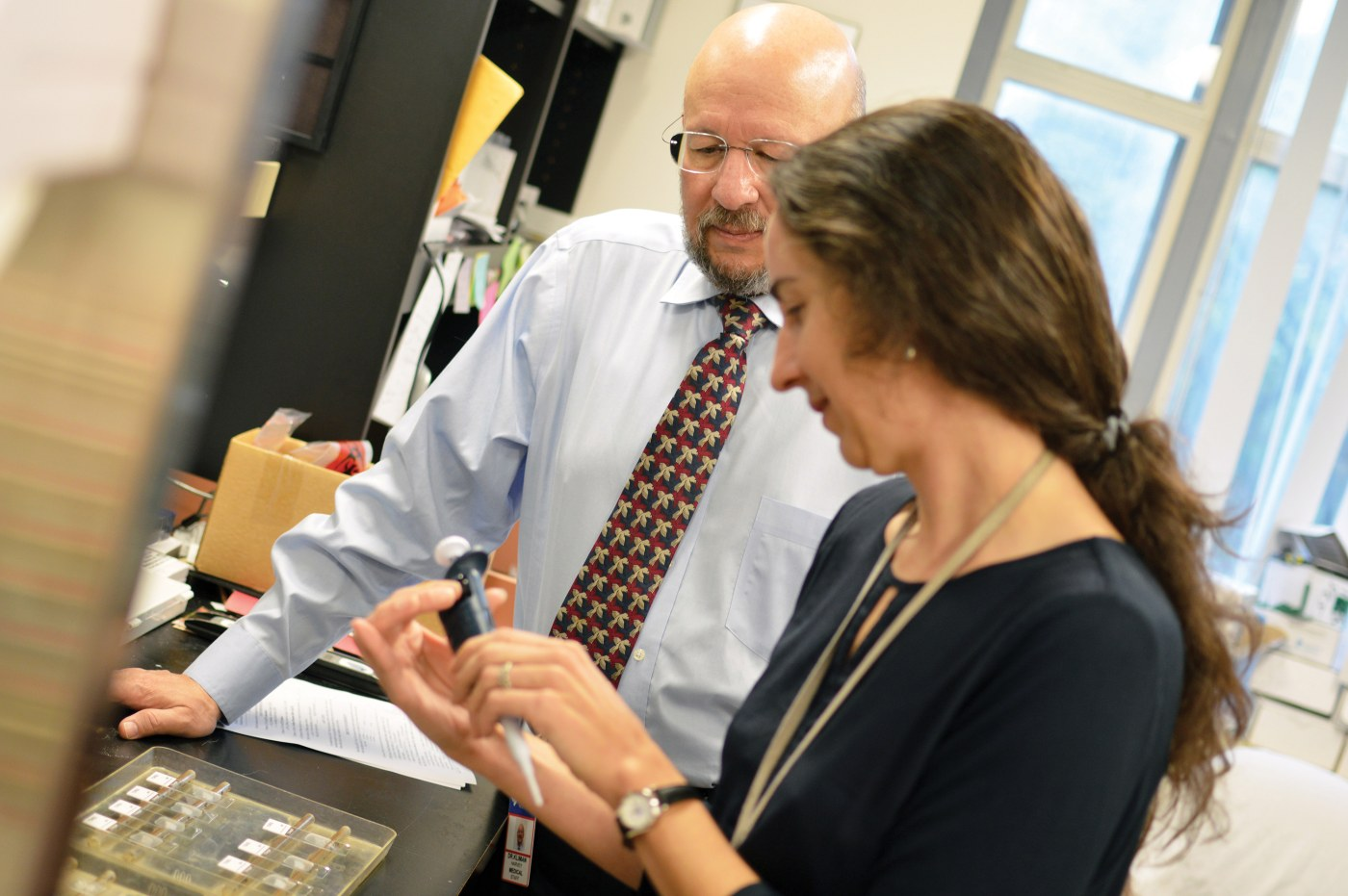 Dr. Harvey Kliman (Left) and research assistant Kristin Milano (right) help women determine if their uterine linings function properly to support a pregnancy.