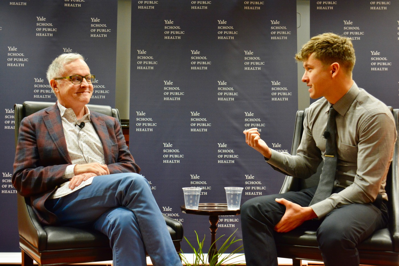 Dr. Neal Baer (left) speaks with Dr. James Hamblin, M.D., M.P.H. '18, about using creative storytelling to convey important messages about public health.