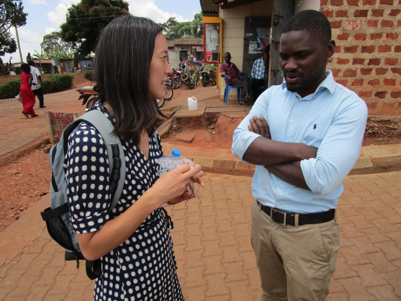 NGN member Dr. Evelyn Hsieh, talking with Dr. Richard Munana, a doctor at ACCESS, outside Nakaseke Hospital.