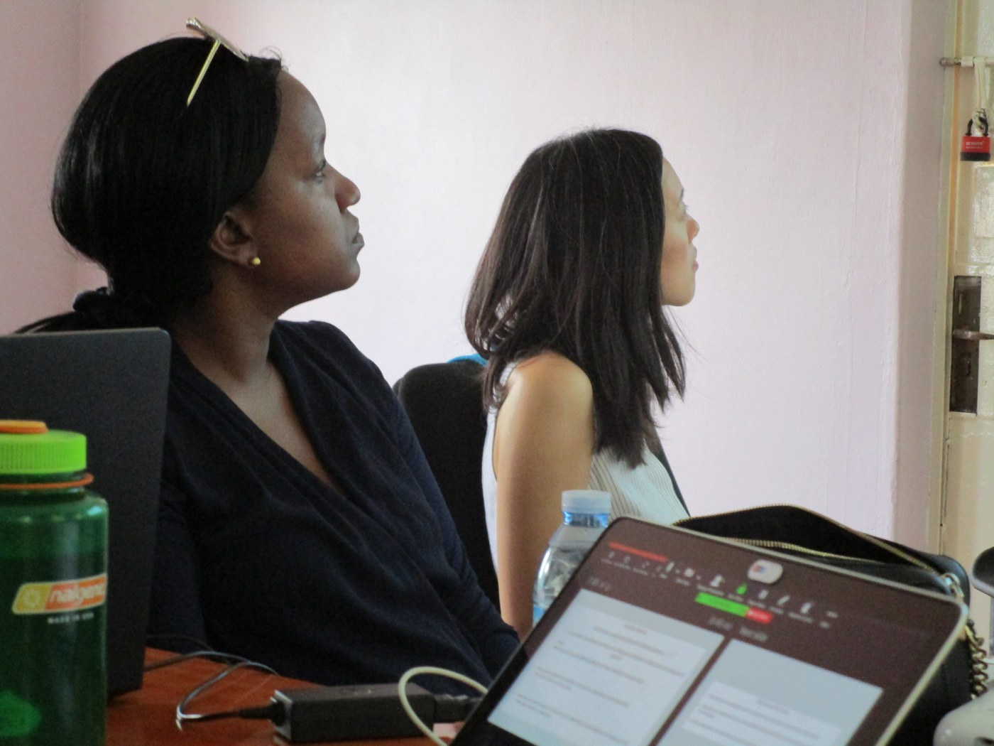 NGN members Drs. Christine Ngaruiya and Evelyn Hsieh, listening to a presentation of data by NGN fellow Sarah Moor (YSM '22).