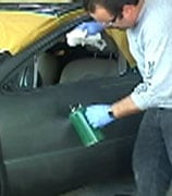 Wear gloves when wiping down a car with solvent.