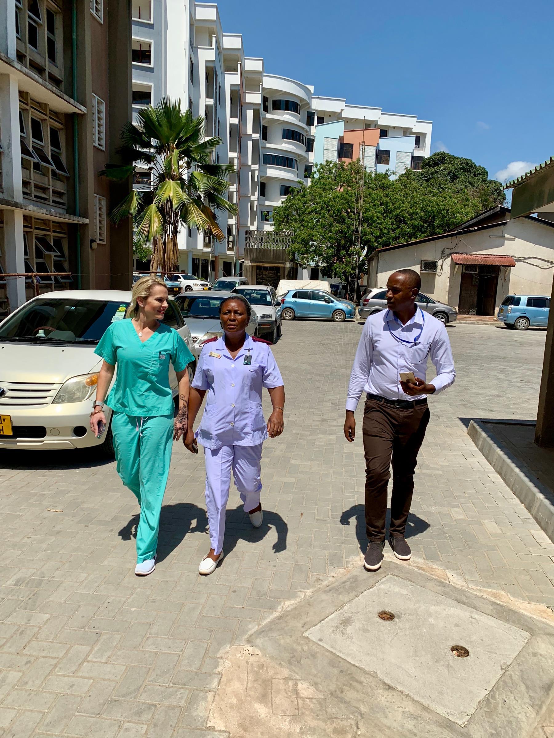 Visiting IR nurse Sarah Wilson from the VA Little Rock, Arkansas, with Tanzanian nurse Bridgita Fwaja and Tanzanian IR resident Dennis Mosha.