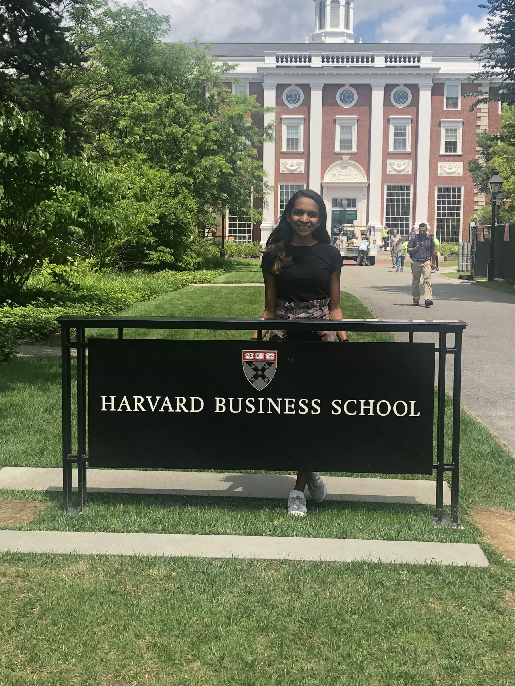Ria at the Harvard Business School sign