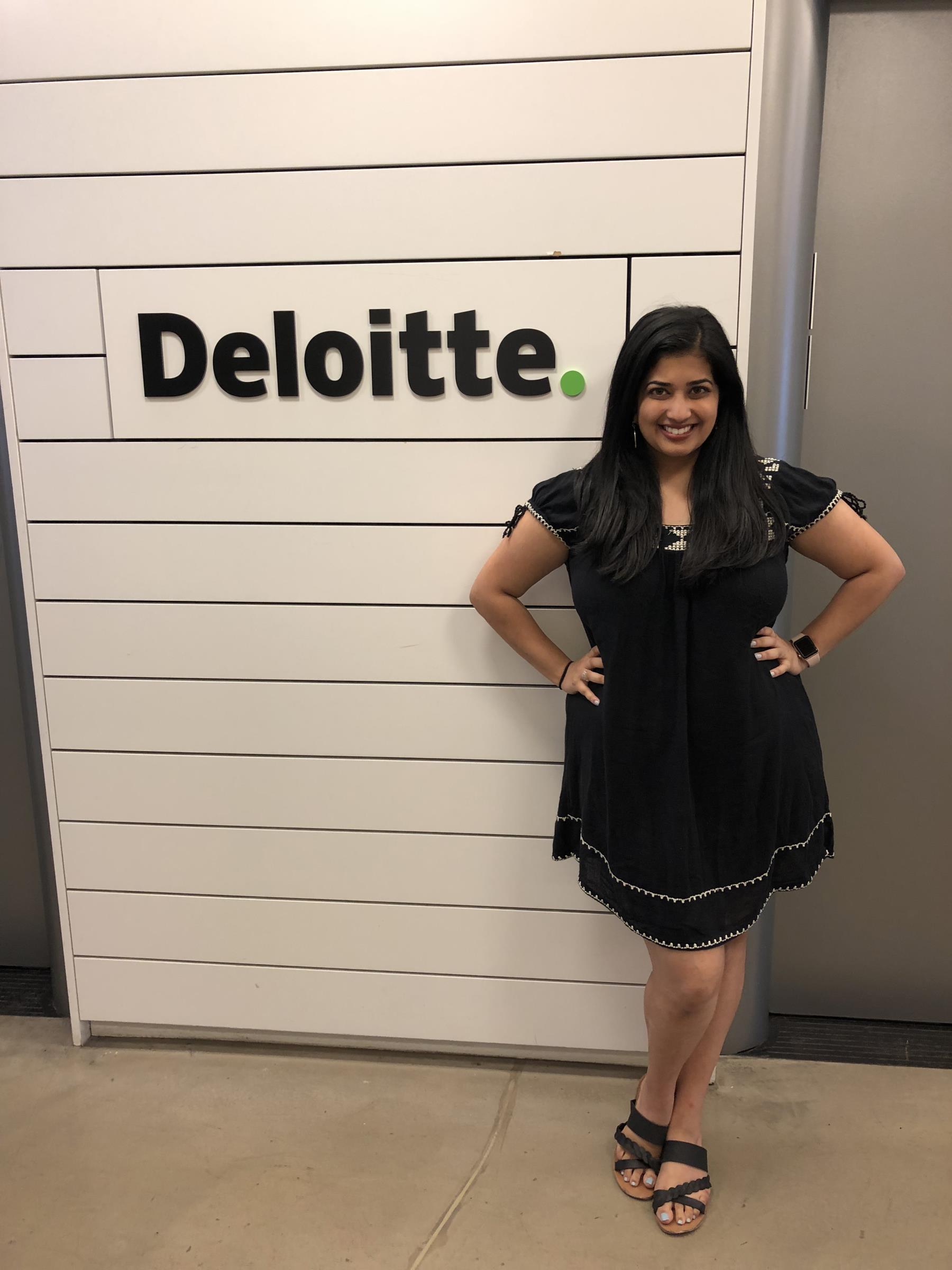 Lisa in front of Deloitte's sign