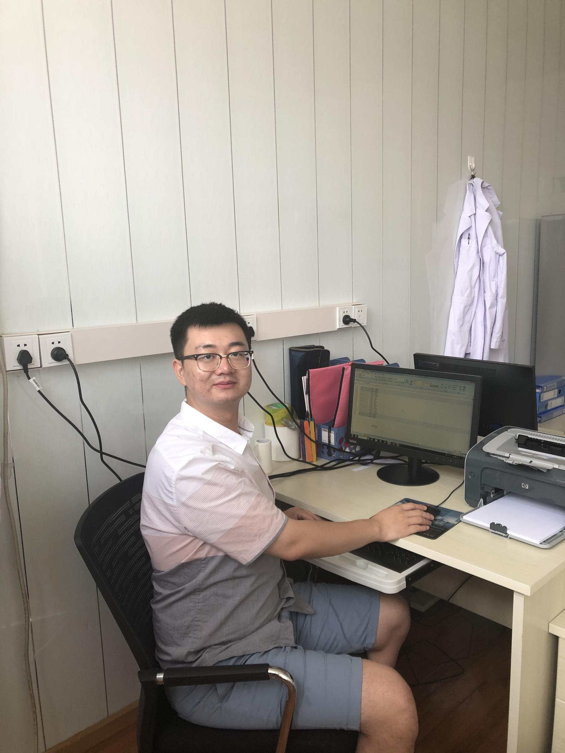 Peiyuan at his desk