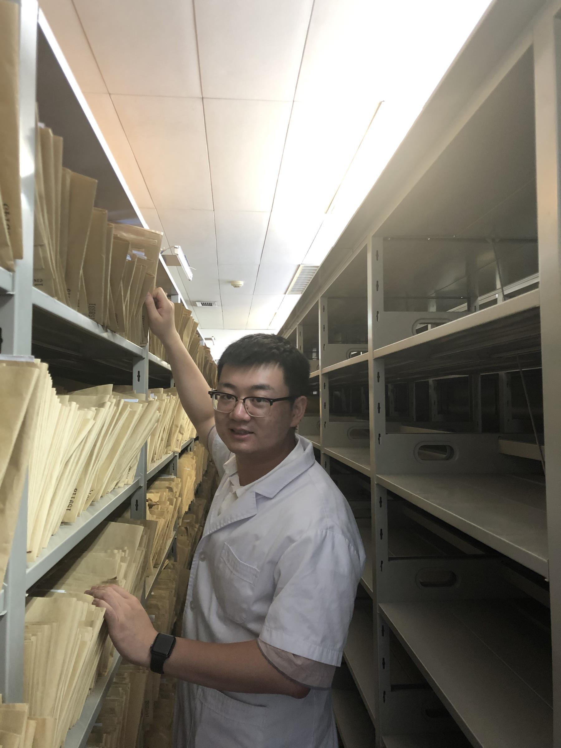 Peiyuan in the file room