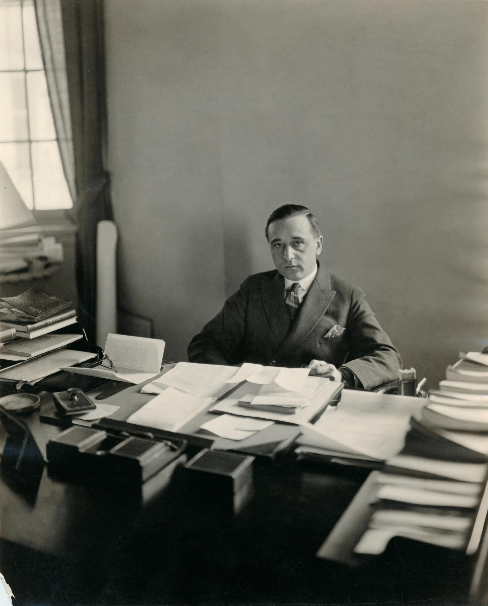 Milton Charles Winternitz looks up from his papers in a photograph dated 1939, four years after he stepped down as dean. During his 15 years leading the school, Winternitz reorganized the medical school departments, recruited a legendary faculty and estab