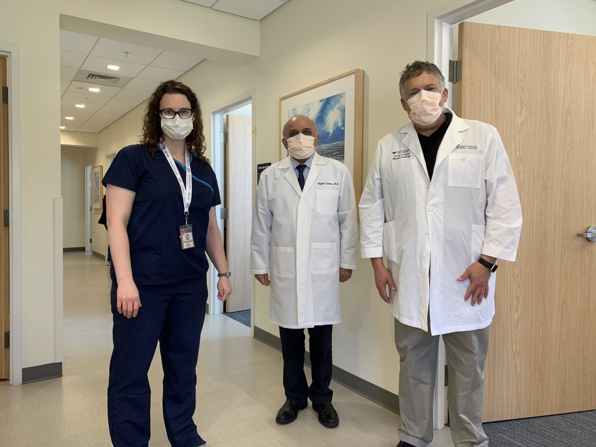 group of three doctors wearing masks