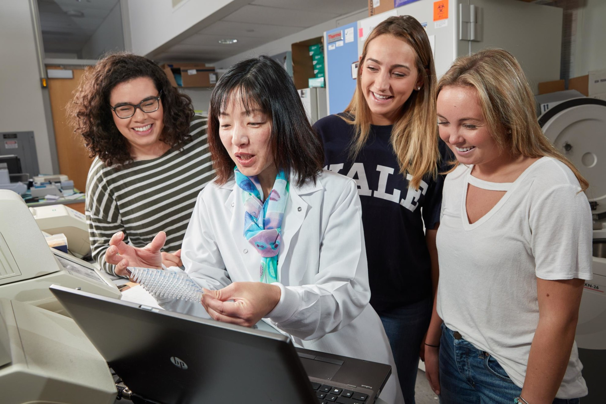 Students discuss lab results with Dr. Akiko Iwasaki