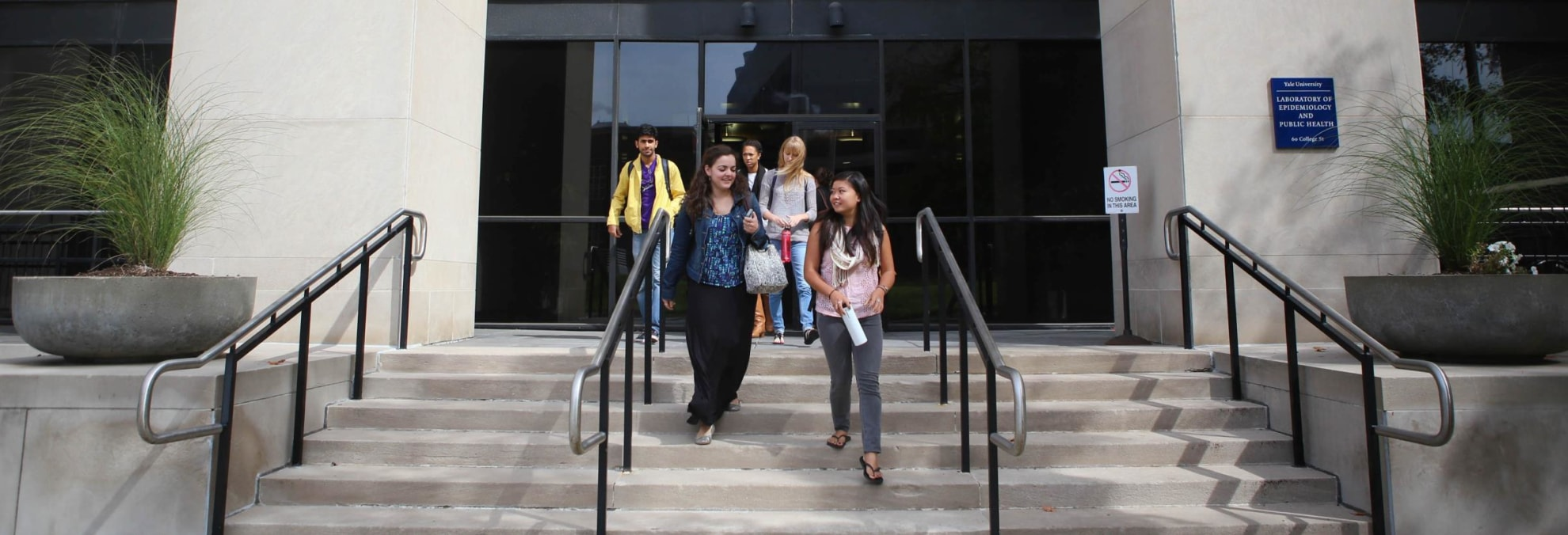 Students on the steps of the Laboratory of Epidemiology and Public Health building